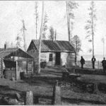 Trader's store at the village of the Pillagers, Cass Lake in the distance on the right. November 26, 1899.