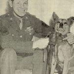 T-Sgt. Harold E. Rogers, with his flying mascot Minster
