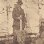 Pamunkey pounding corn in a wooden mortar